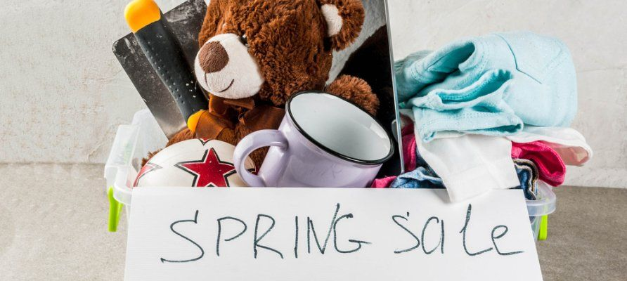 Box of unwanted items being sold during spring cleaning